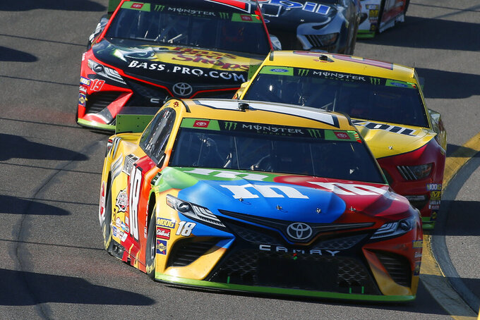 Kyle Busch (18) during the NASCAR Cup Series auto race at ISM Raceway, Sunday, Nov. 10, 2019, in Avondale, Ariz. (AP Photo/Ralph Freso)