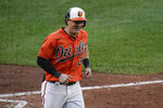 Baltimore Orioles' Austin Hays reacts after hitting a solo home run against the Toronto Blue Jays during the fourth inning of the first game of a baseball doubleheader, Saturday, Sept. 11, 2021, in Baltimore. (AP Photo/Julio Cortez)