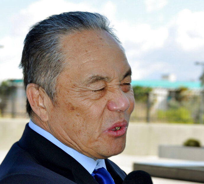 In this Feb. 27, 2014, photo, then-MRI International Inc. President Edwin Fujinaga is asked for comments by the media upon arrival at Federal Court in Las Vegas. Fujinaga, former head of the Las Vegas and Tokyo investment firm, is due to face a federal judge in Nevada on Thursday, May 23, 2019, after a jury found him guilty in November in a fraud case that prosecutors rank with the nation's largest-ever, including Bernard Madoff. (Kyodo News via AP)