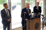 Arkansas Gov. Asa Hutchinson speaks with reporters about the closure of the Interstate 40 bridge connecting his state with Tennessee, Tuesday, May 18, 2021, in Memphis, Tenn. Tennessee Gov. Bill Lee, left, also updated reporters about the bridge closure. (AP Photo/Adrian Sainz)