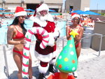 FILE - This July 25, 2019, file photo shows casino employees bringing inflatable pool toys to Santa at the outdoor pool at the Ocean Casino Resort in Atlantic City, N.J. Improvements to pools and cabanas will be part of a $15 million reinvestment the casinos owners are making to the property, they told The Associated Press on Monday, April 19, 2021. (AP Photo/Wayne Parry, File)