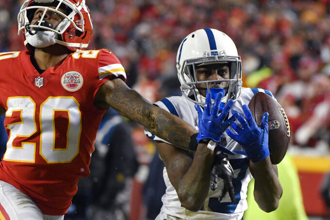 Indianapolis Colts wide receiver T.Y. Hilton (13) makes a touchdown catch against Kansas City Chiefs cornerback Steven Nelson (20) during the second half of an NFL divisional football playoff game in Kansas City, Mo., Saturday, Jan. 12, 2019. (AP Photo/Ed Zurga)