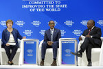 Kristalina Georgieva, CEO of the World Bank, Paul Kagame, President of Rwanda, and Cyril Ramaphosa, President of South Africa, from left, participate in a session at the annual meeting of the World Economic Forum in Davos, Switzerland, Thursday, Jan. 24, 2019. (AP Photo/Markus Schreiber)