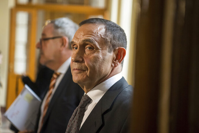 Businessman and former head of the Hungarian Swimming Association Tamas Gyarfas leaves the Metropolitan Court of Budapest after his hearing in Budapest, Hungary, Tuesday, Nov. 12, 2019. Gyarfas is accused of conspiracy to commit murder in the assassination case of media mogul Janos Fenyo in 1998. Gyarfas denies the charge. (Zoltan Balogh/MTI via AP)
