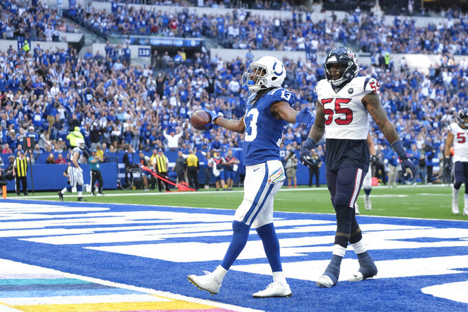 Indianapolis Colts wide receiver T.Y. Hilton celebrates after scoring a touchdown during the first half of an NFL football game against the Houston Texans, Sunday, Oct. 20, 2019, in Indianapolis. (AP Photo/AJ Mast)