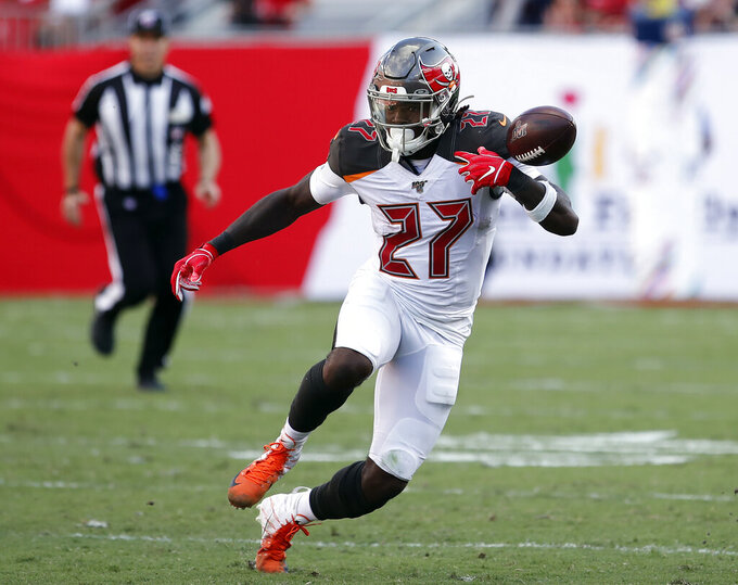 Tampa Bay Buccaneers running back Ronald Jones II (27) fumbles the football on a run against the Arizona Cardinals during the second half of an NFL football game Sunday, Nov. 10, 2019, in Tampa, Fla. (AP Photo/Mark LoMoglio)