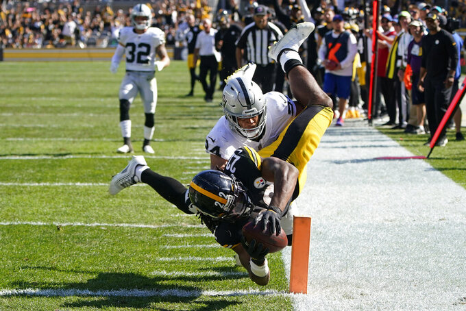 Pittsburgh Steelers running back Najee Harris (22) dives into the end zone with Las Vegas Raiders defensive back Johnathan Abram (24) defending for a touchdown during the second half of an NFL football game in Pittsburgh, Sunday, Sept. 19, 2021. (AP Photo/Keith Srakocic)