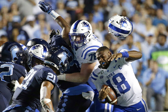 Duke quarterback Quentin Harris (18) loses his helmet during the second half of an NCAA college football game against North Carolina in Chapel Hill, N.C., Saturday, Oct. 26, 2019. (AP Photo/Gerry Broome)