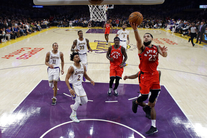 Toronto Raptors' Fred VanVleet (23) scores against the Los Angeles Lakers during the first half of an NBA basketball game Sunday, Nov. 10, 2019, in Los Angeles. (AP Photo/Marcio Jose Sanchez)