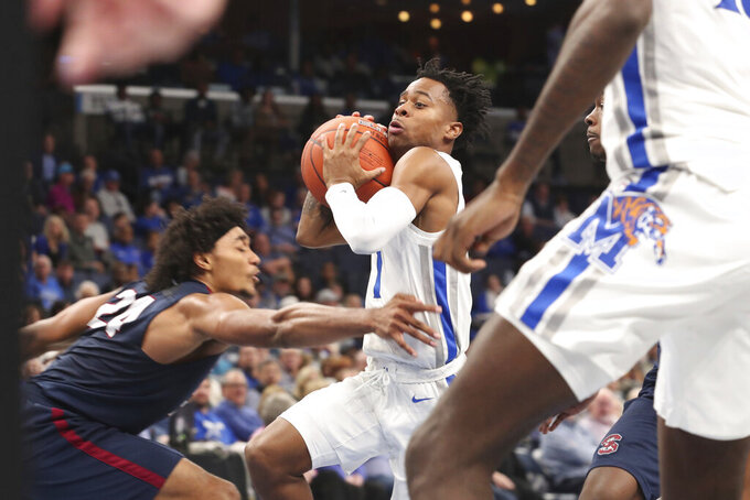 Memphis' Tyler Harris (1) goes up for a basket as South Carolina State Ian Kinard (24) defends during the second half of an NCAA college basketball game Tuesday, Nov. 5, 2019, in Memphis, Tenn. (AP Photo/Karen Pulfer Focht)