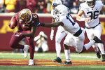 Minnesota wide receiver Tyler Johnson (6) escapes a tackle from Penn State safety Garrett Taylor (17) during an NCAA college football game, Saturday, Nov. 9, 2019, in Minneapolis. (AP Photo/Stacy Bengs)