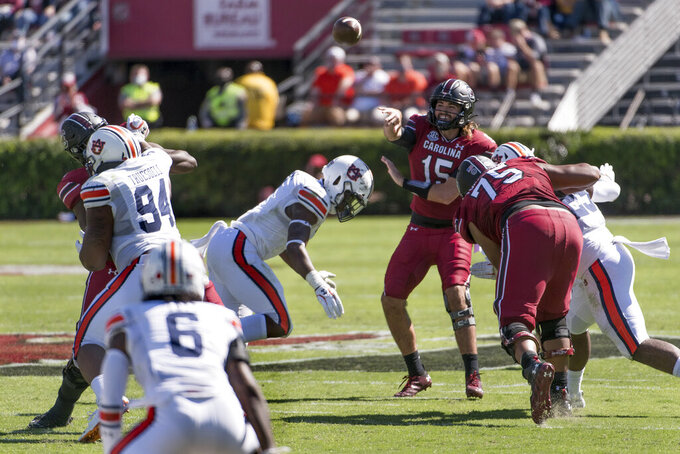 South Carolina quarterback Collin Hill (15) attempts a pass during the first half of an NCAA college football game against Auburn, Saturday, Oct. 17, 2020, in Columbia, S.C. (AP Photo/Sean Rayford)