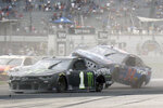 Michael McDowell (34) goes airborne during a second pileup during a NASCAR Series auto race at Indianapolis Motor Speedway, Sunday, Aug. 15, 2021, in Indianapolis. (Randy Crist/The Indianapolis Star via AP)
