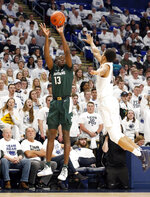 Michigan State's Gabe Brown (13) shoots a three-point basket as Penn State's Rasir Bolton (13) defends during first half action of an NCAA college basketball game in State College, Pa. Sunday, Jan. 13, 2019. (AP Photo/Chris Knight)