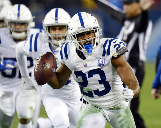 "FILE - In this Dec. 30, 2018, file photo, Indianapolis Colts cornerback Kenny Moore (23) celebrates after intercepting a pass against the Tennessee Titans in the second half of an NFL football game in Nashville, Tenn. Moore has agreed to a four-year contract extension with the Colts. He told reporters he was ""speechless"" following the Colts' final offseason workout Thursday, June 13, 2019. (AP Photo/Mark Zaleski, File)"