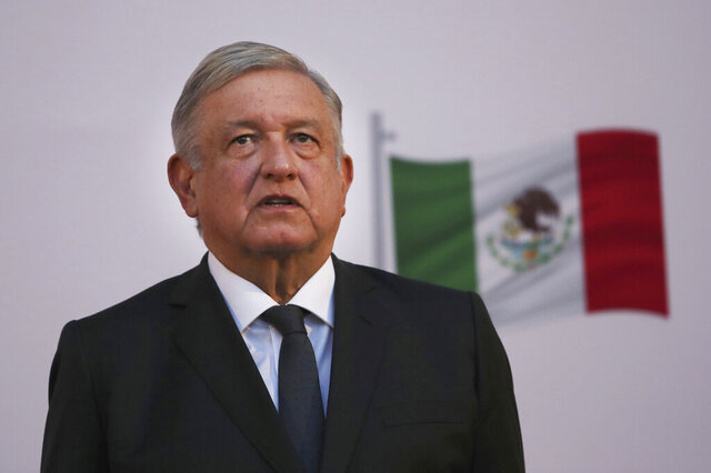 Mexican President Andrés Manuel López Obrador stands during the commemoration of his second anniversary in office, at the National Palace in Mexico City, on Tuesday, December 1, 2020. (AP Photo / Marco Ugarte )