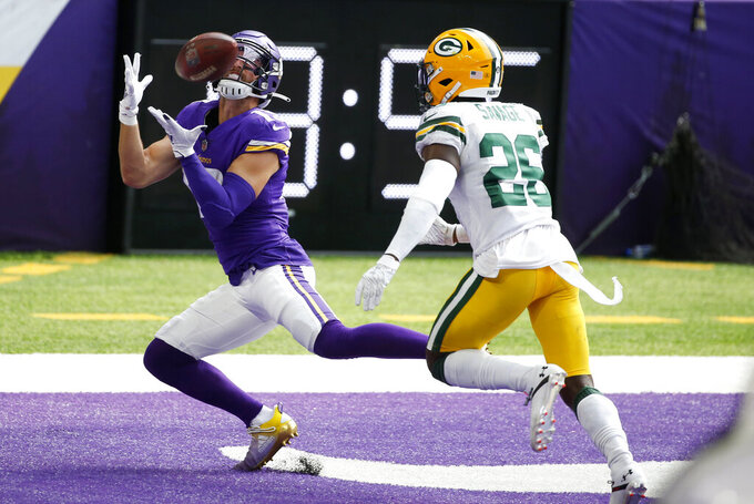 Minnesota Vikings wide receiver Adam Thielen catches a 37-yard touchdown pass ahead of Green Bay Packers safety Darnell Savage, right, during the second half of an NFL football game, Sunday, Sept. 13, 2020, in Minneapolis. (AP Photo/Bruce Kluckhohn)