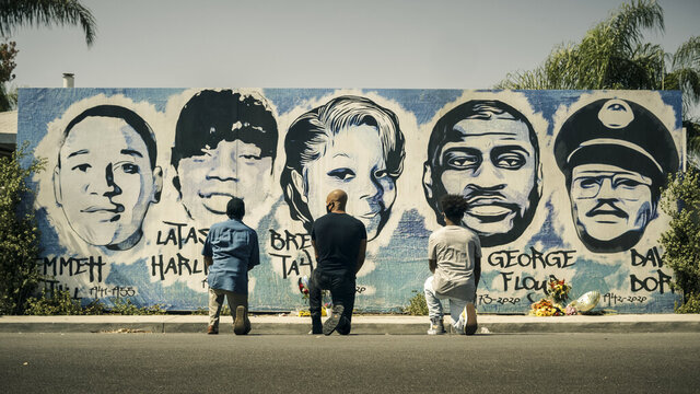 This image released by CBS shows Obba Babatund, portraying Daniel Harrison Sr., from left, Shemar Moore, portraying his son Hondo, and Deshae Frost, as Darryl, kneel in front of a mural in a scene from