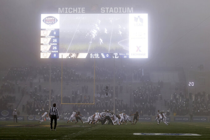 Army takes on Navy during a foggy first half of an NCAA college football game Saturday, Dec. 12, 2020, in West Point, N.Y. (AP Photo/Adam Hunger)