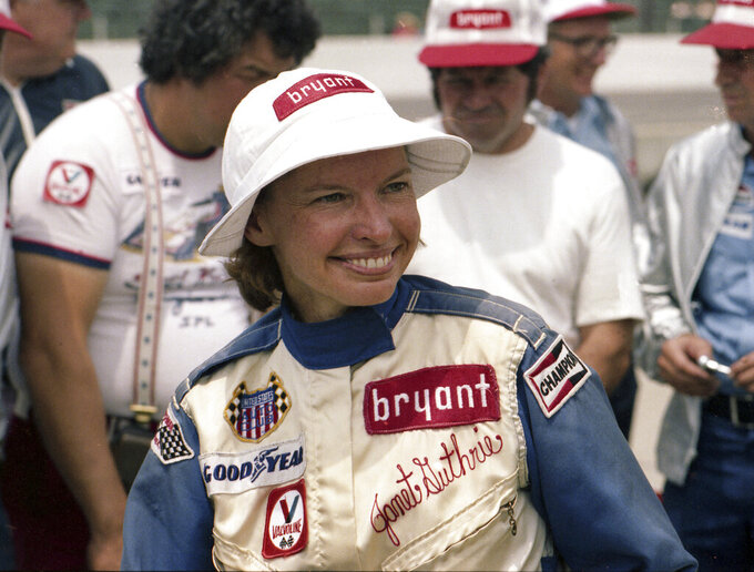 In this 1977 photo provided by Indianapolis Motor Speedway, driver Janet Guthrie smiles at Indianapolis Motor Speedway in Indianapolis, Ind. There was no warm reception for Janet Guthrie when she arrived at Indianapolis Motor Speedway 43 years ago. She wanted a spot in the biggest race in the world and her competitors didn't want her anywhere near the Indianapolis 500.  (Indianapolis Motor Speedway via AP)