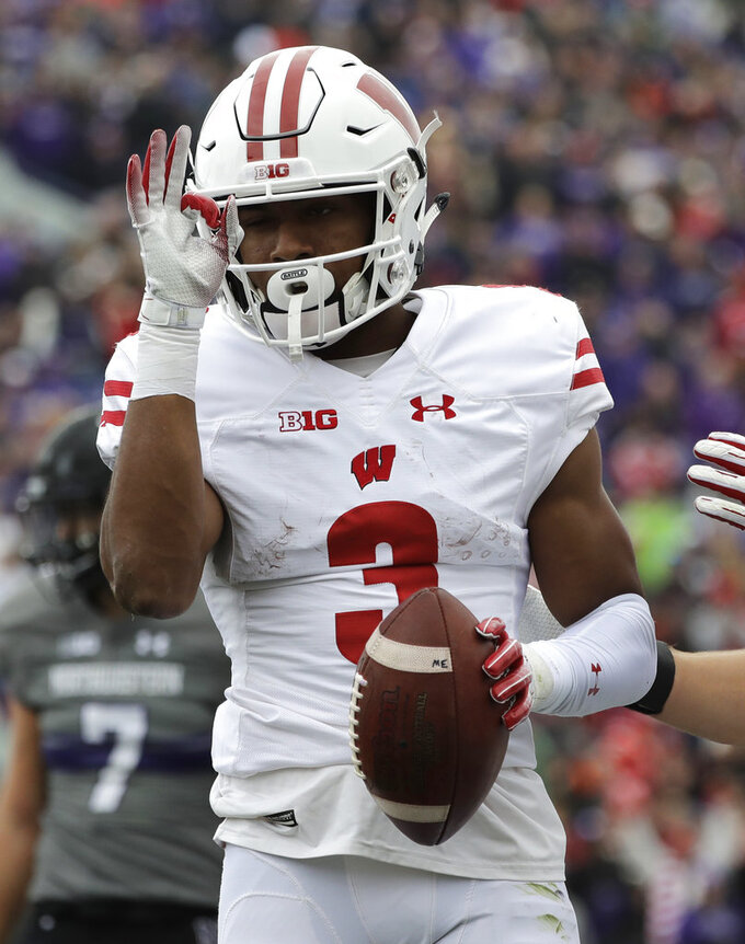 Wisconsin wide receiver Kendric Pryor celebrates after catching a touchdown pass during the second half of an NCAA college football game against Northwestern in Evanston, Ill., Saturday, Oct. 27, 2018. Northwestern won 31-17. (AP Photo/Nam Y. Huh)