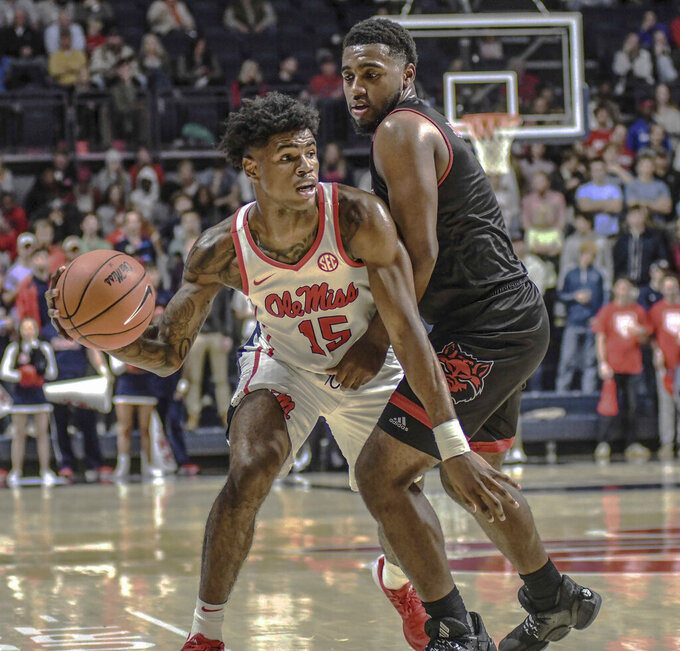 Mississippi's Luis Rodriguez (15) passes around Arkansas State's Jerry Johnson Jr. (1) during the first half of an NCAA college basketball game, Friday, Nov. 8, 2019 in Oxford, Miss. (Bruce Newman/The Oxford Eagle via AP)