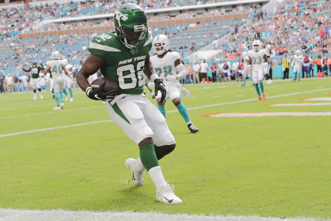 New York Jets wide receiver Jamison Crowder (82) runs the ball in for a touchdown against the Miami Dolphins during the first half of an NFL football game, Sunday, Nov. 3, 2019, in Miami Gardens, Fla. (AP Photo/Lynne Sladky)
