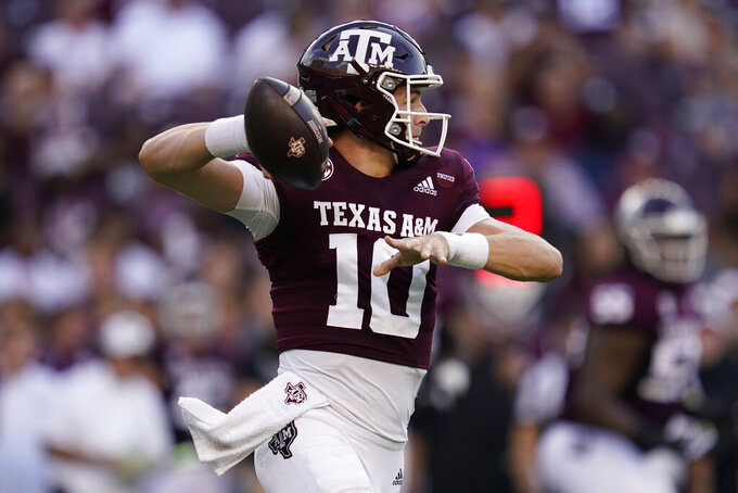 Texas A&M quarterback Zach Calzada (10) passes down field against Mississippi State during the first quarter of an NCAA college football game, Saturday, Oct. 2, 2021, in College Station, Texas. (AP Photo/Sam Craft)