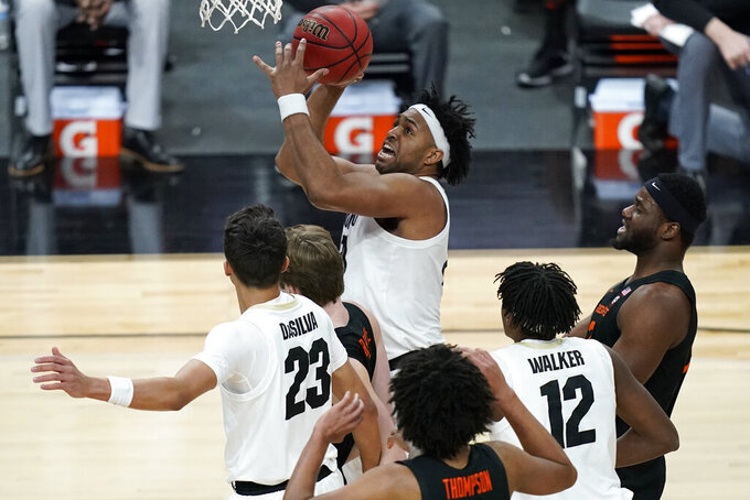 Colorado's Evan Battey (21) shoots against Oregon State during the first half of an NCAA college basketball game in the championship of the Pac-12 men's tournament Saturday, March 13, 2021, in Las Vegas. (AP Photo/John Locher)