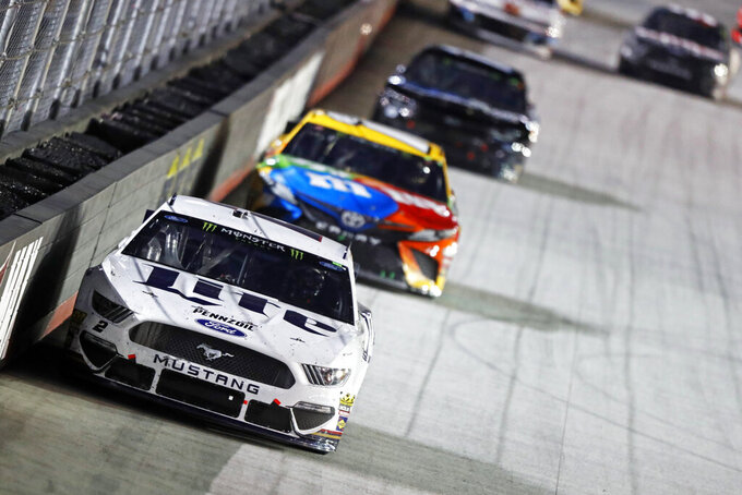 Brad Keselowski (2) leads Kyle Busch and others down the back straight during the NASCAR Cup Series auto race Saturday, Aug. 17, 2019, in Bristol, Tenn. (AP Photo/Wade Payne)