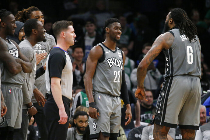 Brooklyn Nets guard Caris LeVert (22) celebrates with center DeAndre Jordan (6) late in overtime of the team's NBA basketball game against the Boston Celtics, Tuesday, March 3, 2020, in Boston. (AP Photo/Mary Schwalm)