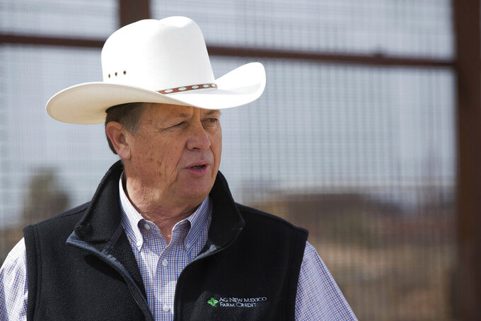 FILE - In this March 6, 2018, file photo, Aubrey Dunn, then New Mexico State Land Commissioner, stands near a section of the U.S./ Mexico Border in Santa Teresa, N.M. A special congressional election is underway for an Albuquerque-based seat dominated by Democrats since 2009. Early voting by absentee ballot begins Tuesday, May 4, 2021 as major party candidates participate in their first public debate.(Josh Bachman/The Las Cruces Sun-News via AP)