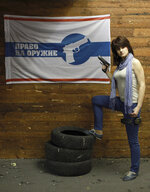 In this photo taken on Sunday, April 22, 2012, Maria Butina, a gun-rights activist, poses for a photo at a shooting range in Moscow, Russia. When gun activist Maria Butina arrived in Washington in 2014 to network with the NRA, she was peddling a Russian gun rights movement that was already dead. Fellow gun enthusiasts and arms industry officials describe the strange trajectory of her Russian gun lobby project, which U.S. prosecutors say was a cover for a Russian influence campaign. Accused of working as a foreign agent, Butina faces a hearing Monday, Sept. 10 in Washington. (AP Photo/Pavel Ptitsin)