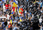 Protesters try to push through a riot police line outside the government headquarters, in Bucharest, Romania, Friday, Aug. 10, 2018. Romanians who live abroad have begun an anti-government protest calling on the left-wing government to resign and an early election. The expatriates, some of whom drove across Europe for the demonstration, are angry about the Romania is governed. (AP Photo/Vadim Ghirda)