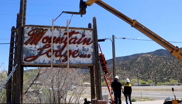 This April 16, 2020 image provided by Build It Right shows the Mountain Lodge Motel sign along historic Route 66 near Albuquerque, N.M., as it's being removed before being placed into storage. The sign was donated to the city of Albuquerque so it can be put on display at the planned Route 66 Visitor Center. (Lucas Luna/Build It Right  via AP)