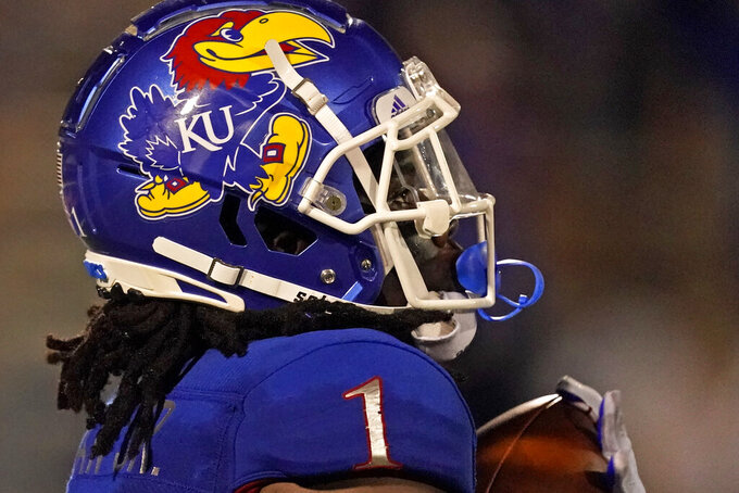 Kansas safety Kenny Logan Jr. (1) returns a kick for 83 yards during the second half of an NCAA college football game against South Dakota Friday, Sept. 3, 2021, in Lawrence, Kan. Kansas won 17-14. (AP Photo/Charlie Riedel)