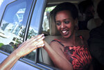 Diane Rwigara, the country's most prominent opposition figure, smiles as a wellwisher shakes her hand after being acquitted of charges related to her election challenge of President Paul Kagame, at the high court in Kigali, Rwanda Thursday, Dec. 6, 2018. Rwanda's high court on Thursday acquitted Rwigara of all charges, as judges said the prosecution failed to provide proof of insurrection and forgery. (AP Photo)