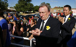 Cardiff City manager Neil Warnock, second righ, and Cardiff City CEO Ken Choo, right, applaud during the burial of Emiliana Sala, at the cemetery in Santa Fe, Argentina, Saturday, Feb. 16, 2019. The Argentina-born forward died in an airplane crash in the English Channel last month when flying from Nantes in France to start his new career with English Premier League club Cardiff. (AP Photo/Natacha Pisarenko)