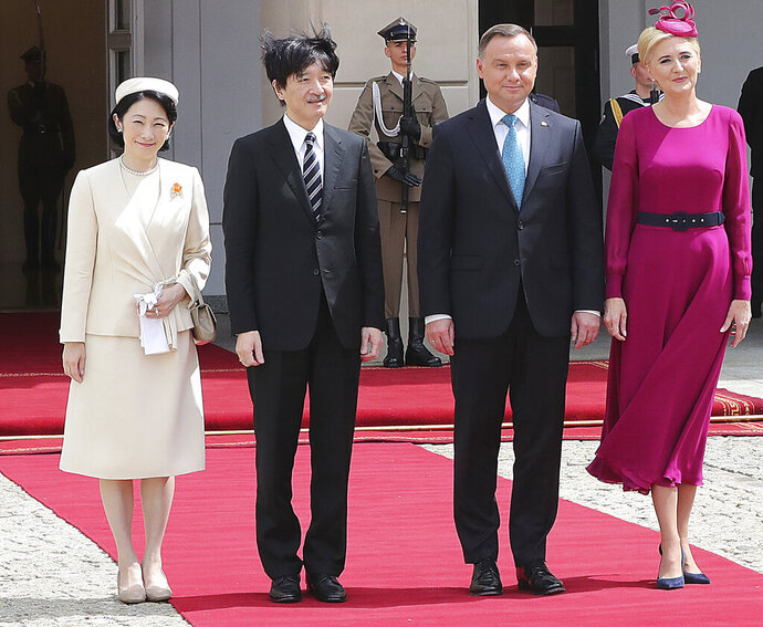 Polish President Andrzej Duda and first lady Agata Kornhauser-Duda welcome Japan's Crown Prince Akishino and his wife Crown Princess Kiko at the Presidential Palace as the Japanese royal couple began a tour of Poland in Warsaw, Poland, Friday, June 28, 2019. The visit marks the centenary of diplomatic relations between Poland and Japan. (AP Photo/Czarek Sokolowski)