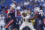 New England Patriots quarterback Mac Jones, left, passes while pressured by New Orleans Saints defensive end Cameron Jordan (94) during the second half of an NFL football game, Sunday, Sept. 26, 2021, in Foxborough, Mass. (AP Photo/Mary Schwalm)