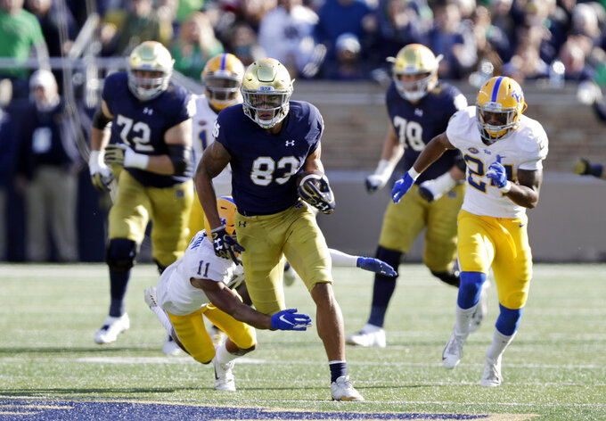 Notre Dame wide receiver Chase Claypool (83) is tackled by Pittsburgh defensive back Dane Jackson (11) during the second half of an NCAA college football game, Saturday, Oct. 13, 2018, in South Bend, Ind. Notre Dame won 19-14. (AP Photo/Darron Cummings)