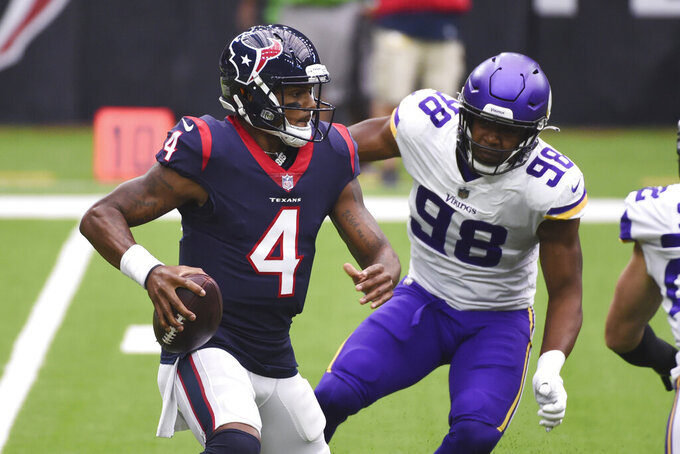 Houston Texans quarterback Deshaun Watson (4) is pressured by Minnesota Vikings defensive end D.J. Wonnum (98) during the first half of an NFL football game Sunday, Oct. 4, 2020, in Houston. (AP Photo/Eric Christian Smith)