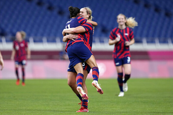 United States' Christen Press (11) celebrates with Lindsey Horan after scoring a goal during a women's soccer match at the 2020 Summer Olympics, Saturday, July 24, 2021, in Saitama, Japan. (AP Photo/Martin Mejia)