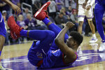 Kansas center Udoka Azubuike (35) lands with an injured ankle during the first half of an NCAA college basketball game against Kansas State in Manhattan, Kan., Saturday, Feb. 29, 2020. (AP Photo/Orlin Wagner)