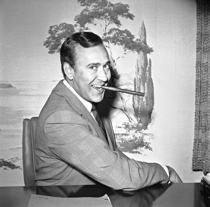 """FILE - In this May 25, 1967 file writer-comedian Carl Reiner poses in his new hairpiece in Los Angeles. Reiner, the ingenious and versatile writer, actor and director who broke through as a """"second banana"""" to Sid Caesar and rose to comedy's front ranks as creator of """"The Dick Van Dyke Show"""" and straight man to Mel Brooks' """"2000 Year Old Man,"""" has died, according to reports. Variety reported he died of natural causes on Monday night, June 29, 2020, at his home in Beverly Hills, Calif. He was 98. (AP Photo/Harold Filan, File)"""