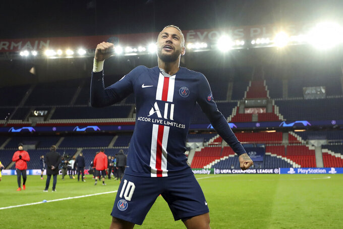 Paris Saint Germain's Neymar celebrates after the Champions League round of 16 second leg soccer match between PSG and Borussia Dortmund, Wednesday March 11, 2020 in Paris. The match is being played in an empty stadium because of the coronavirus outbreak. (UEFA via AP)