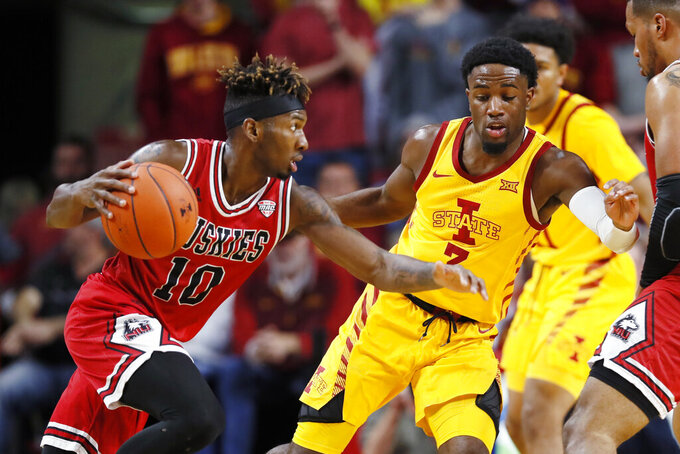Northern Illinois guard Eugene German (10) drives past Iowa State guard Tre Jackson during the first half of an NCAA college basketball game, Tuesday, Nov. 12, 2019, in Ames, Iowa. (AP Photo/Charlie Neibergall)