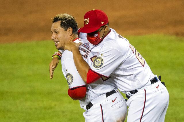 Washington Nationals Juan Soto (22) celebrates with teammate Asdrubal Cabrera, left, after winning 5-3 in a baseball game against the New York Mets in Washington, Tuesday, Aug. 4, 2020. (AP Photo/Manuel Balce Ceneta)