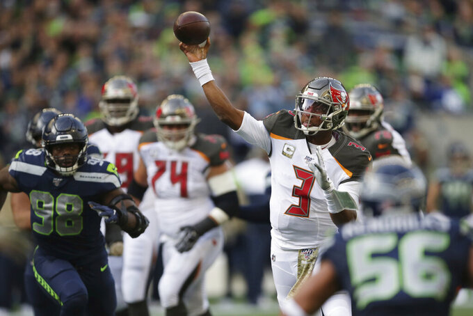 Tampa Bay Buccaneers quarterback Jameis Winston passes to wide receiver Mike Evans (not shown) for a touchdown during the first half of an NFL football game against the Seattle Seahawks, Sunday, Nov. 3, 2019, in Seattle. (AP Photo/Scott Eklund)