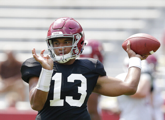 FILE - In this Aug. 5, 2017 file photo Alabama quarterback Tua Tagovailoa throws the ball during an NCAA college football practice at Bryant–Denny Stadium in Tuscaloosa, Ala. Tagovailoa signed a $30.275 million, four-year guaranteed contract with the Miami Dolphins, a person familiar with the negotiations confirmed Monday, May 11, 2020 to The Associated Press. (AP Photo/Brynn Anderson, file)